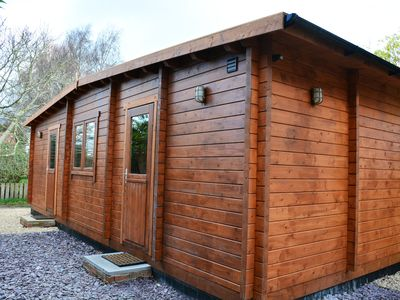 Photo for A quiet and peaceful log cabin. Just 5 minutes from the centre of Glastonbury.
