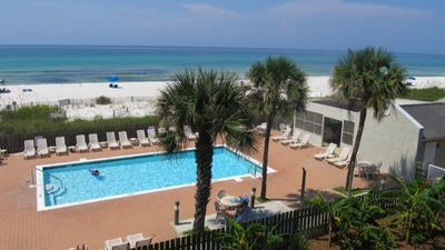 View of pool and beach from the upstairs balcony all within steps of each other!