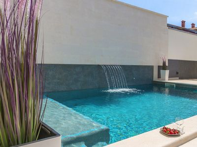 Photo for Luxury apartment with private backyard and pool