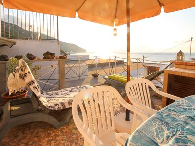 Photo for Seaside apartment in Acquacalda w/ terrace & views - steps to a pebble beach!