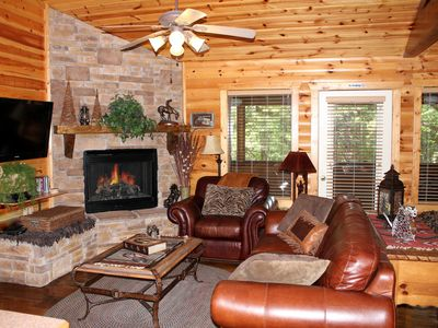 Photo for July Special $105.00* Log Cabin*Fireplace*Jacuzzi*WIFI*Cable*Porch* pools*workou