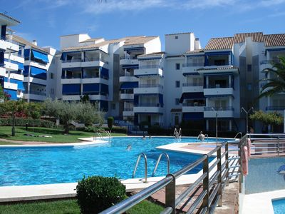 Photo for Apartment with terrace, green area and swimming pools, 100 meters from the beach.