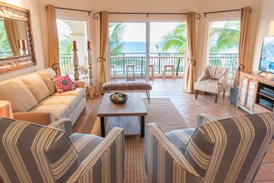 Beautifully furnished living room with sweeping ocean views.