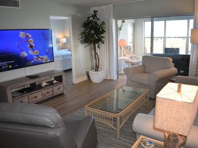 Photo for Remodeled & on the beach! Front door only steps to the pool. Bright end unit!
