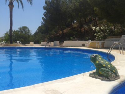 Large communal swimming pool and terrace