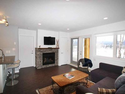 Living room featuring 39' flat screen TV, gas fireplace and private covered deck