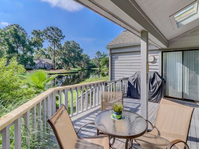 Photo for Intimate condo w/ pool access and tennis courts - minutes to the beach