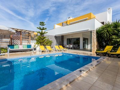 Photo for Modern semi-detached villa, private pool, garden, AC, free WiFi, walk to beach