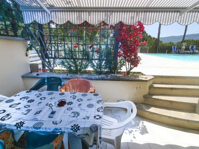 Photo for Residence with pool and an amazing view in Porto Azzurro close to the beach and the centre.