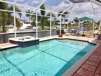 Photo for Enjoy Western Exposure Sunsets, Gulf Access, Large Heated Pool, WIFI