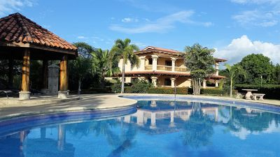 Photo for Luxury Condo with Large Pool, walking distance to beach to pristine Beach.
