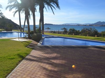 Photo for Beach front modern apartment with spectacular sea and mountain views