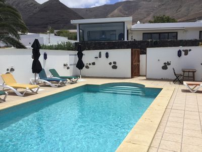 Photo for Spacious, modern accommodation with fully heated pool and spectacular views
