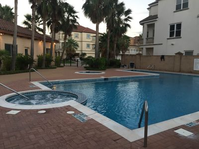 Beautiful large outdoor pool & hot tubs. Gated community.