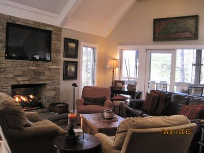 Main living area with large flatscreen TV and gas fireplace