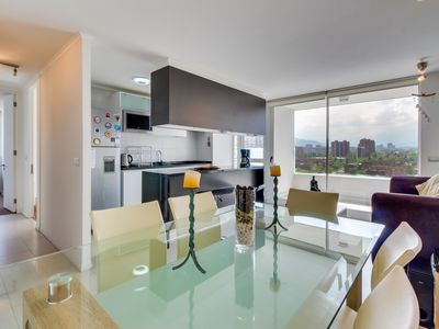 Stylish Las Condes apartment with a shared pool. Walk everywhere!