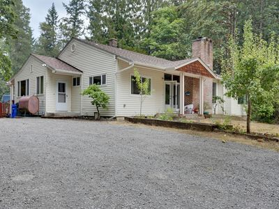 Photo for Dog-friendly riverfront retreat for entertaining with private hot tub!