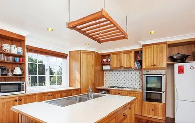 Fully equipped kitchen with dishwasher, two ovens, large gas stove, fridge, etc