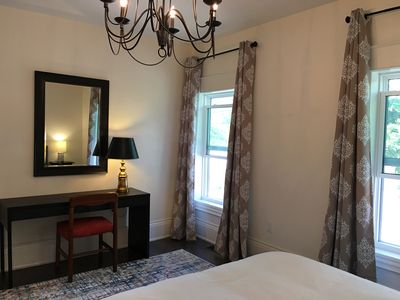 This master bedroom view features the writing desk lighting.