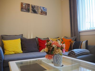 Bright, fresh living room with large, comfortable sofa