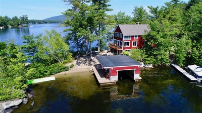 Photo for Classic Winnipesaukee Lake House on Point Lot with Sand Beach