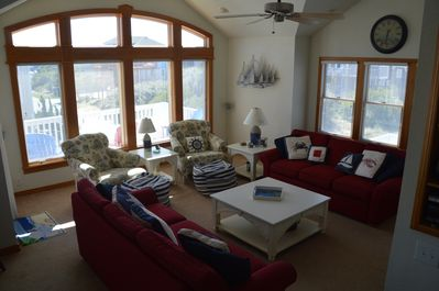 Great room with deck access, open to kitchen and dining area
