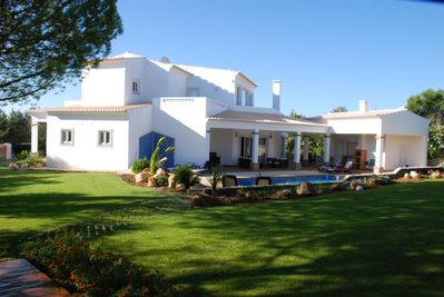 Villa, pool area and gardens