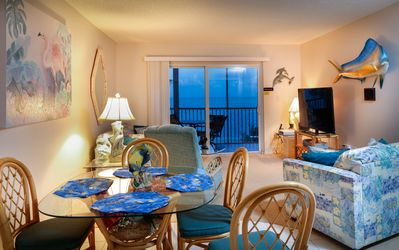 living room/dining area with access to the balcony overlooking the ocean