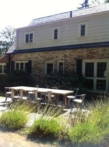 Flagstone patio with farm table seating for 10