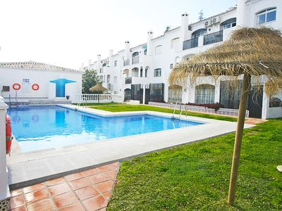 Photo for Wonderful floor in Verano Azul! Large sunny terrace, two pools, central, beautiful