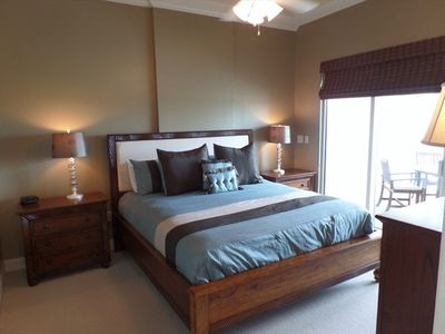King size bed in the master bedroom suite with balcony access