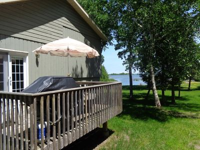 Cottage deck with BBQ and table off kitchen