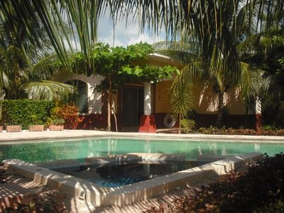 View across jacuzzi & pool to Casa 5. Gardens fully mature, colorful and shady.