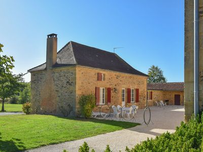 Photo for Cottage on a beautiful lake with a lovely garden and courtyard.