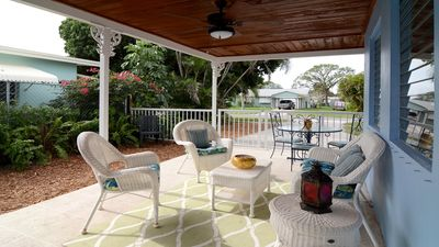 Bring your morning coffee and evening cocktails to enjoy under the covered patio