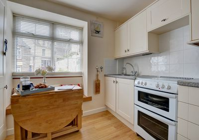 Compact kitchen with dining table