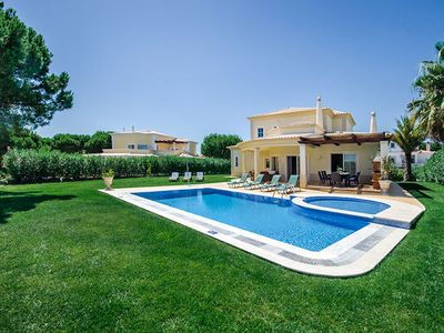 Photo for An exclusive, four bedroom villa bordering the Vila Sol Golfe Course overlooking the putting green o