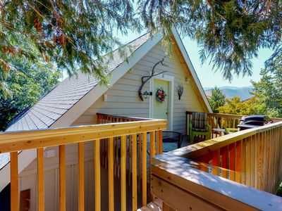 Photo for Charming top-floor studio suite w/private deck & partial lake and mountain views