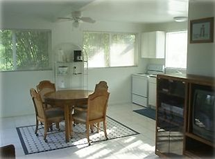 Plenty of room in our sunny kitchen or you can dine in the screened in lanai!