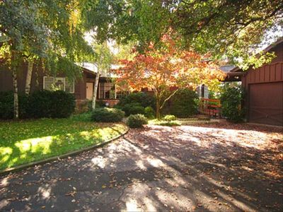 This 1950s home w/ Wheel chair ramp is built on top of a 1.6 acre wooded knoll.