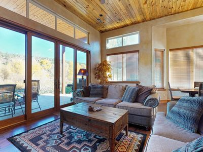 Photo for NEW LISTING! Beautiful waterfront condo w/ river & mountain views
