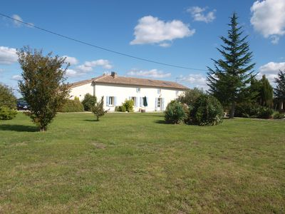 Photo for Five bedroom farmhouse with large pool, large garden and coastal views