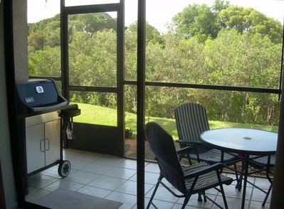 Screened lanai with partial view of canal