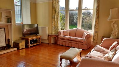 Sitting room with working open fire and Sky box, DVD player.