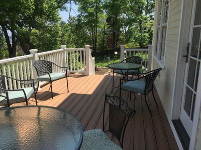 Back deck leading to grill and brick patio.