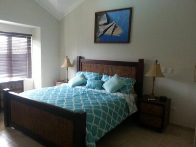 master bedroom with cal king and new bedding