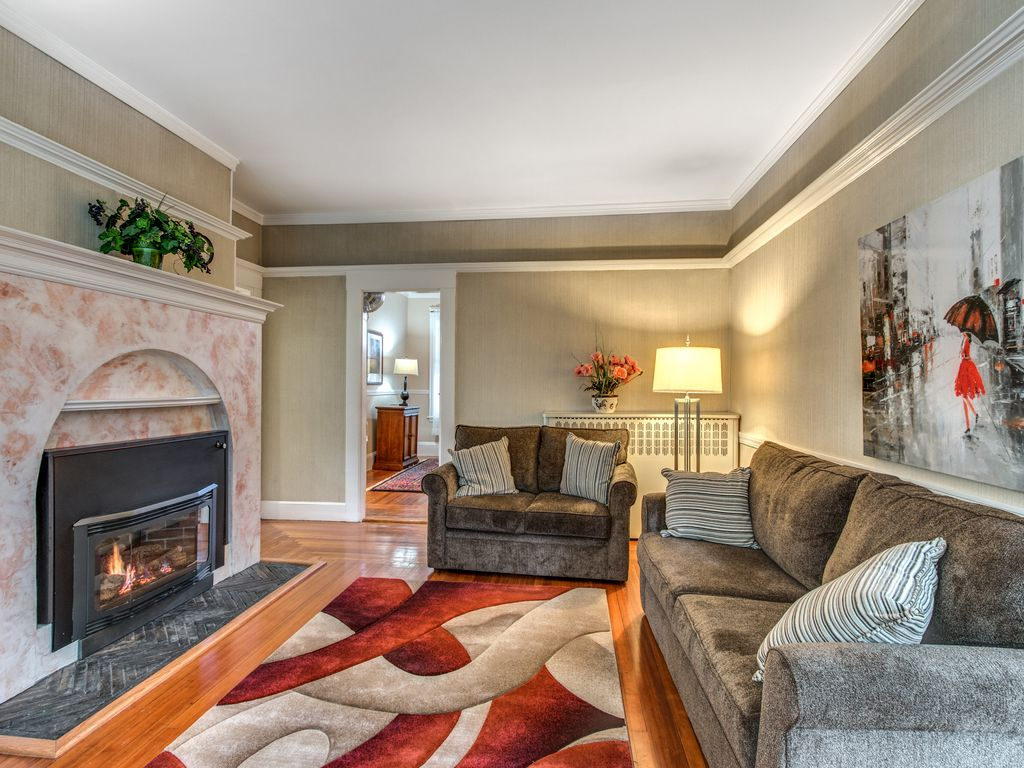 Living Room Featuring High Ceilings Beautiful Mouldings And A Gas Fireplace