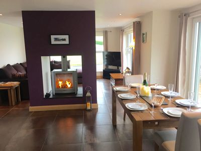 Open plan Kitchen/Lounge/Dining area with large extending dining table & stove