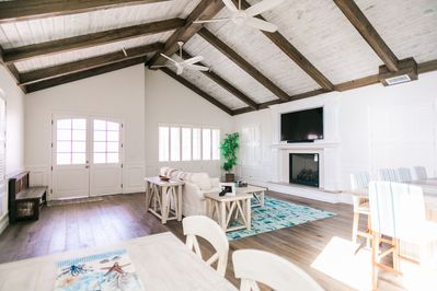 Spacious great room with 19ft ceilings. 9ft bi-fold doors open up completely.