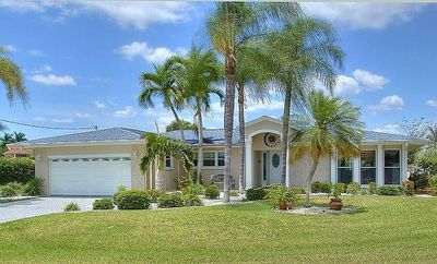 Photo for Beautiful villa with pool by a canal, with sail boat access to Gulf of Mexico